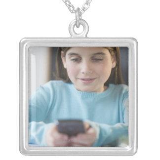 Girl texting in classroom silver plated necklace