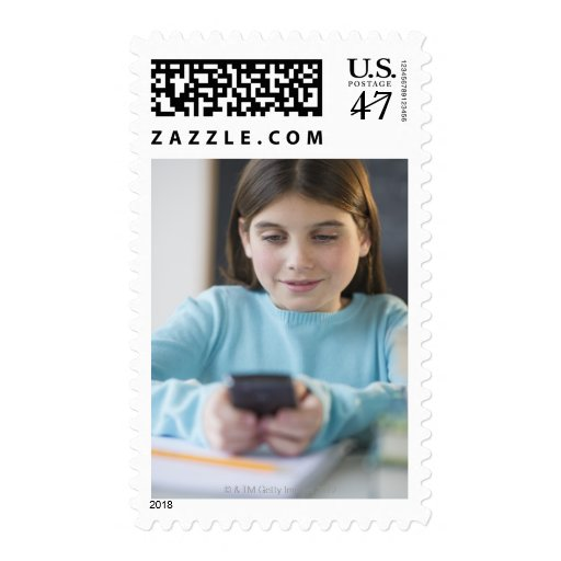 Girl texting in classroom stamp