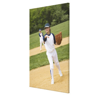 Girl throwing in little league softball game canvas print