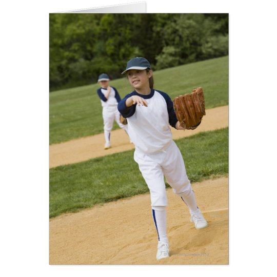 Girl throwing in little league softball game card