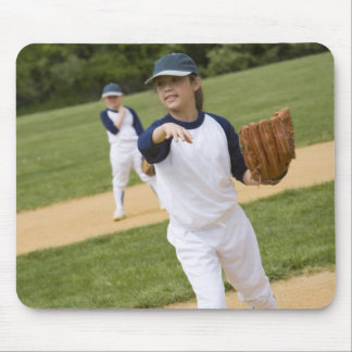 Girl throwing in little league softball game mouse pad