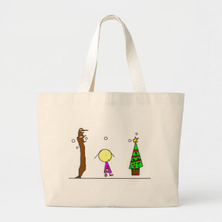 Girl walking in the snow large tote bag