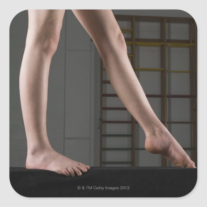 Girl walking on balance beam square sticker