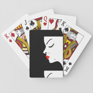 Girl with a beauty spot on chin playing cards