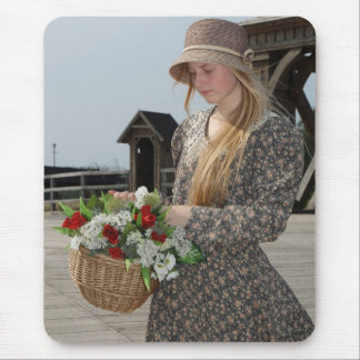 Girl with basket of flowers mouse pad
