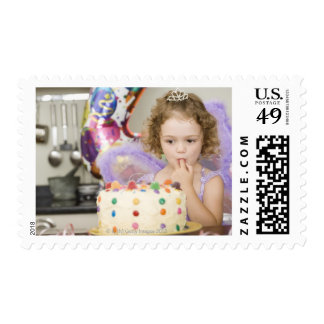 Girl with birthday cake postage stamps