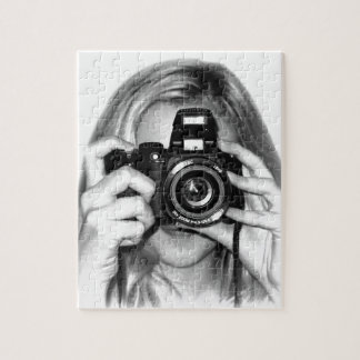 Girl with camera puzzles