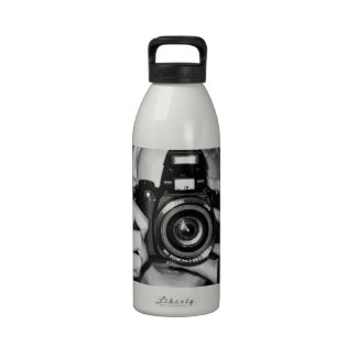 Girl with camera water bottles