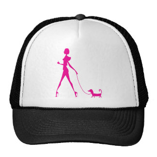 girl with dog trucker hat