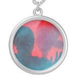 Girl with hand up by dolphin blue pink colored necklaces