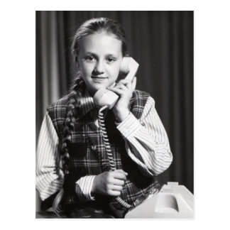 Girl with old telephone postcard