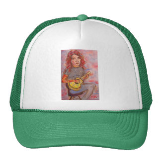 girl with red hair and ukulele trucker hat