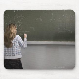 Girl writing on blackboard mouse pad