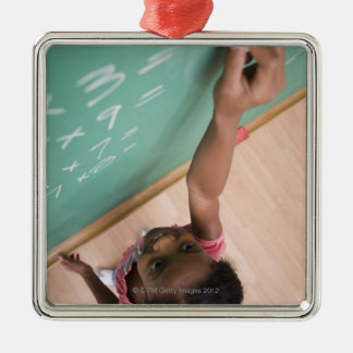 Girl writing on chalkboard metal ornament