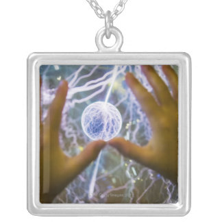 Girls hands on a plasma ball silver plated necklace