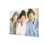 Girls having a facial canvas prints