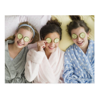 Girls having a facial post cards