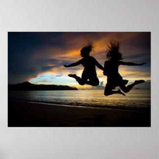 Girls Jumping Beach sunset Poster