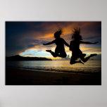 Girls Jumping Beach sunset Posters