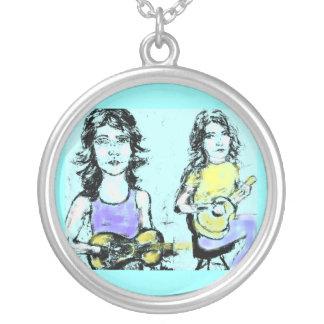 girls playin' music round pendant necklace