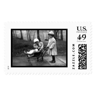 Girls Playing with a Doll in a Carriage 1912 Postage Stamp