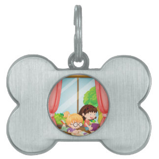 Girls reading book pet ID tags