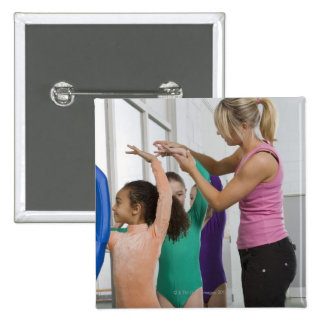 Girls stretching in gymnastics class pinback button
