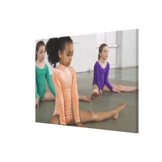 Girls stretching in gymnastics practice canvas print