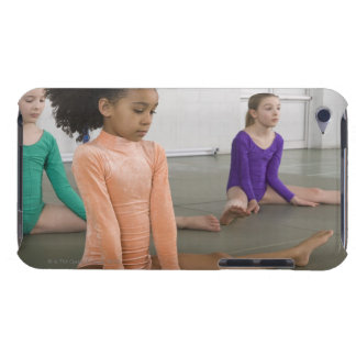 Girls stretching in gymnastics practice iPod touch cover