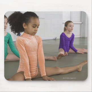 Girls stretching in gymnastics practice mouse pads