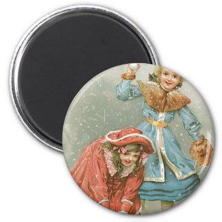 Girls Throwing Snowballs, Merry Christmas Magnet