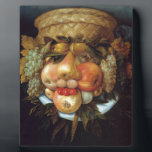 """Giuseppe Arcimboldo&#39;s Reversible Head with Basket Plaque<br><div class=""""desc"""">Best known for creating imaginative portraits from fruits,  vegetables,  flowers,  fish,  and books,  Italian artist Giuseppe Arcimboldo (1527 - 1593) is an excellent example of why you should be playing with your food.</div>"""