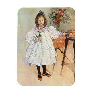 Gladys que sostiene un color de rosa rosado iman