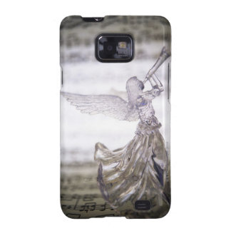 Glass angel playing trumpet and image of sheet galaxy SII case