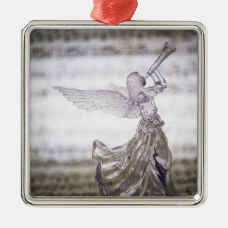 Glass angel playing trumpet and image of sheet square metal christmas ornament