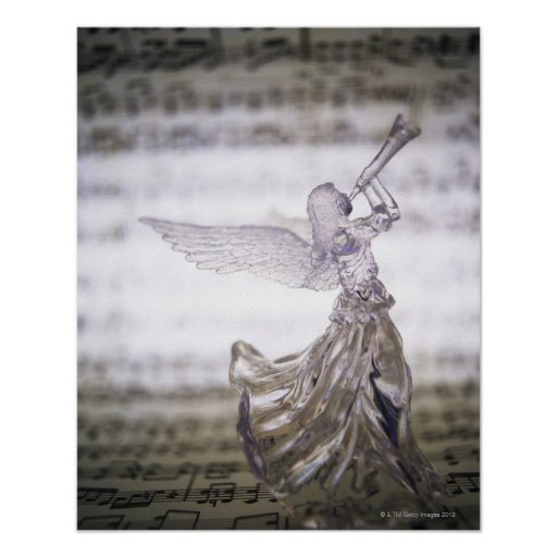 Glass angel playing trumpet and image of sheet posters