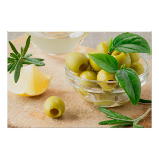 Glass cup with green pitted olives poster