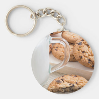 Glass cup with milk and oatmeal cookies keychain
