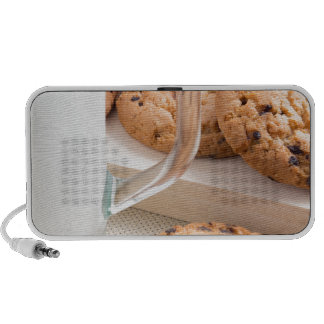 Glass cup with milk and oatmeal cookies portable speaker