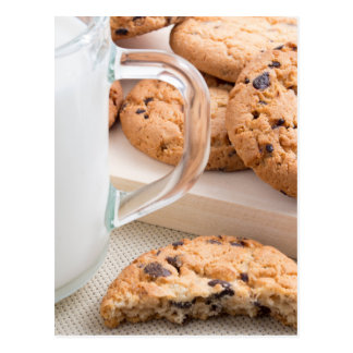 Glass cup with milk and oatmeal cookies postcard