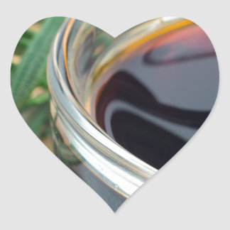 Glass cup with soy sauce and rosemary leaves close heart sticker