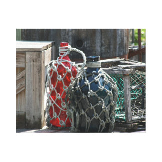 Glass fishing floats red blue infront canvas print