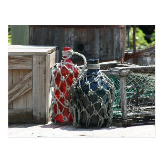 Glass fishing floats red blue infront postcard