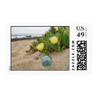 Glass Float and yellow ice plant. Postage