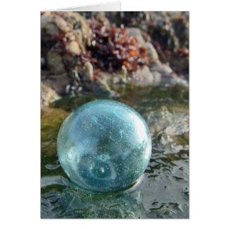 Glass float near tide pool card