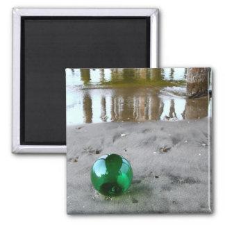 Glass float under pier magnet