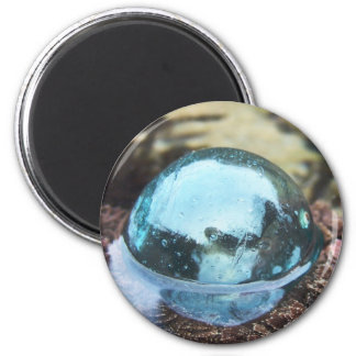 Glass floating in tide pool magnet