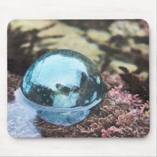 Glass floating in tide pool mouse pad