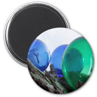 Glass floats on gray driftwood 2 inch round magnet