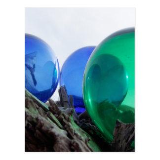 Glass floats on gray driftwood postcard
